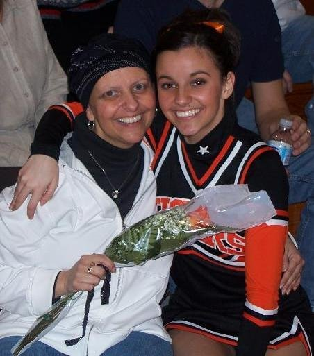 Sami presenting her mom with a flower at a basketball game she cheered at.